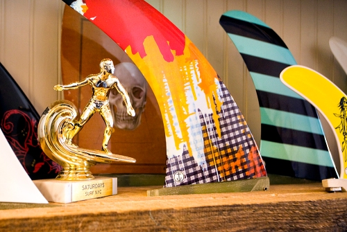 A mock surf trophy lines the shelf at Soho's Saturdays Surf.